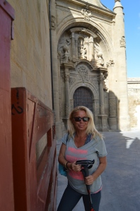 Jackie at the bull gate (they hold bull runs here too) in fron of the ruins of San Pedro