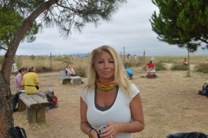 Jackie at a break areea along the Camino. Note the Pilgrims at rest. Near Ciruena