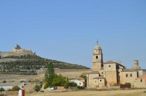 Castrojeriz castle overlooks town and church