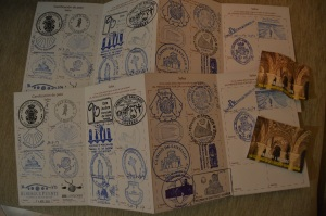 Our Pilgrim Passports with stamps from along the Camino. At right are admission tickets to see the Grail.