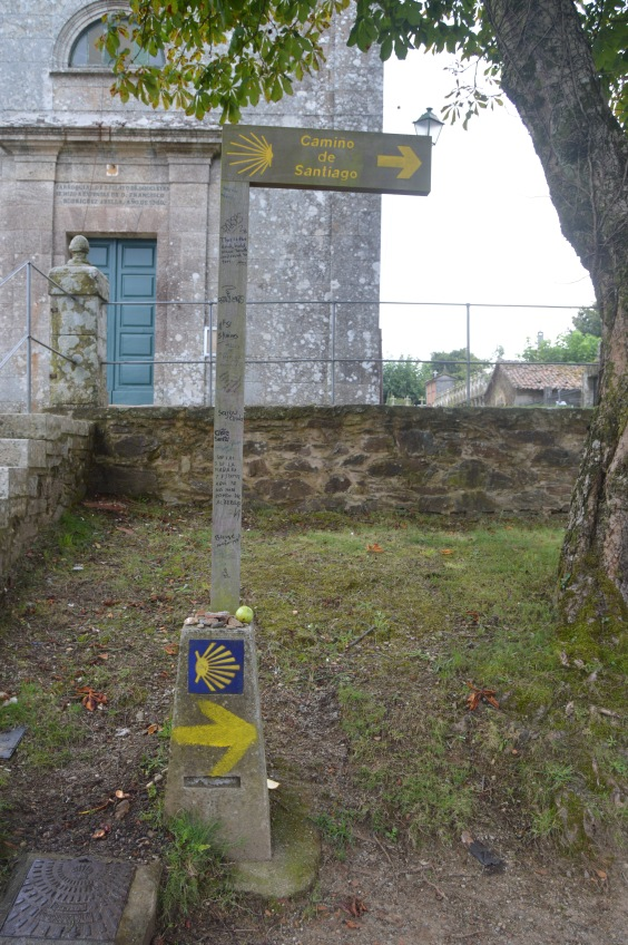 Another arrow in front of another church